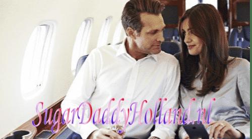 Gelukkig man en vrouw in vliegtuig